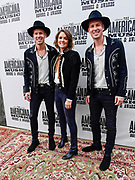 NASHVILLE, TENNESSEE - SEPTEMBER 11: (L-R) Tim Hanseroth, Brandi Carlile and Phil Hanseroth arrive at the 18th Annual Americana Honors & Awards at Ryman Auditorium on September 11, 2019 in Nashville, Tennessee.