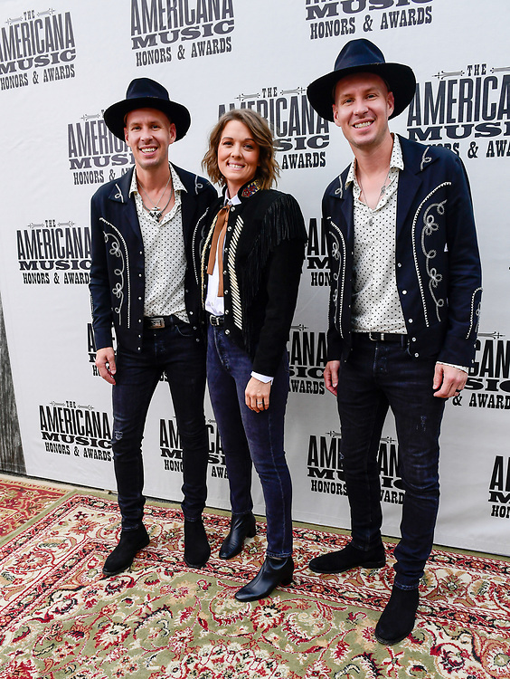 NASHVILLE, TENNESSEE - SEPTEMBER 11: (L-R) Tim Hanseroth, Brandi Carlile and Phil Hanseroth arrive at the 18th Annual Americana Honors & Awards at Ryman Auditorium on September 11, 2019 in Nashville, Tennessee.