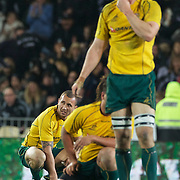 A dejected Quade Cooper (left) and Dan Vickerman after the Wallabies loss during the New Zealand V Australia Tri-Nations, Bledisloe Cup match at Eden Park, Auckland. New Zealand. 6th August 2011. Photo Tim Clayton