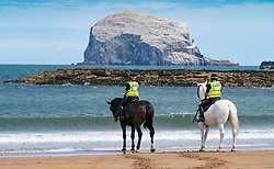 Mounted police patrol beach at North Berwick during Covid-19 pandemic lockdown, East Lothian, Scotland, UK