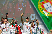 The portuguese team captain Cristiano Ronaldo and other portuguese football players taking pictures of the crowd of portuguese supporters at Alameda Dom Afonso Henriques, in Lisbon. Portugal's national squad won the Euro Cup the day before, beating in the final France, the organizing country of the European Football Championship, in a match that ended 1-0 after extra-time.