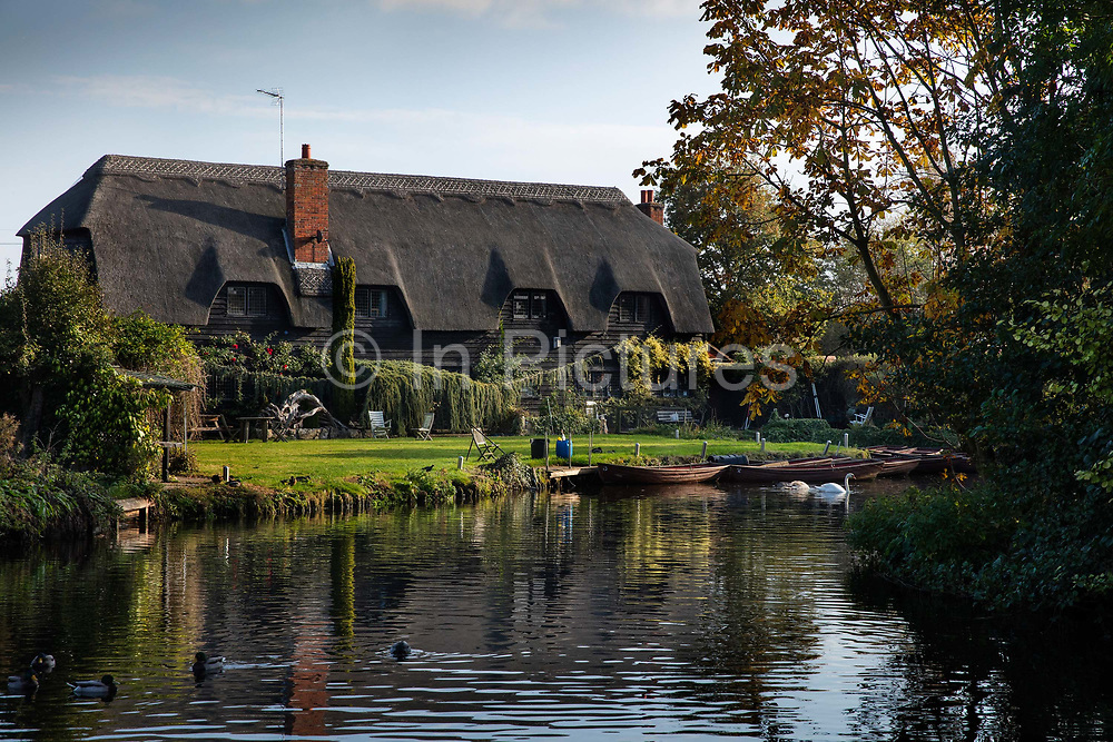 Granary Barn across the River Stour, Flatford Mill. The mill was owned by the artist John Constables father and is noted, along with its immediate surroundings as the location for many of Constables works. It is referred to in the title of one of his most iconic paintings, Flatford Mill Scene on a Navigable River, and mentioned in the title or is the subject of several others including: Flatford Mill from a lock on the river Stour.