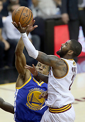 The Cleveland Cavaliers' Kyrie Irving, right, is fouled by the Golden State Warriors' Andre Iguodala in the second quarter during Game 4 of the NBA Finals at Quicken Loans Arena in Cleveland on Friday, June 9, 2017. (Photo by Phil Masturzo/Akron Beacon Journal/TNS) *** Please Use Credit from Credit Field ***