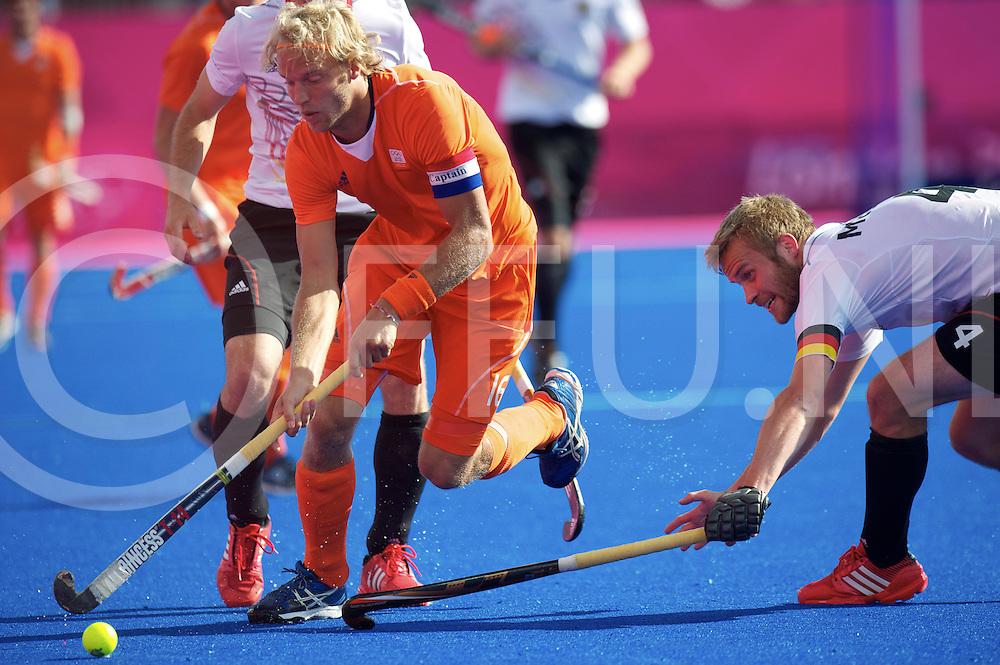 LONDON - Olympische Spelen 2012.men .match: Netherlands v Germany 3-1.foto:Floris Evers en Maximilian Muller [C].FFU PRESS AGENCY COPYRIGHT FRANK UIJLENBROEK.