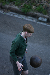 A boy plays football during a scene in the making of the film Five Seconds Of Silence in Hampstead, north London, Thursday March 31, 2016. The film, set in 1942, features Brad Pitt as a spy who marries a French agent, played by Marion Cotillard. EXPA Pictures © 2016, PhotoCredit: EXPA/ Photoshot/ Johnny Green<br /> <br /> *****ATTENTION - for AUT, SLO, CRO, SRB, BIH, MAZ, SUI only*****