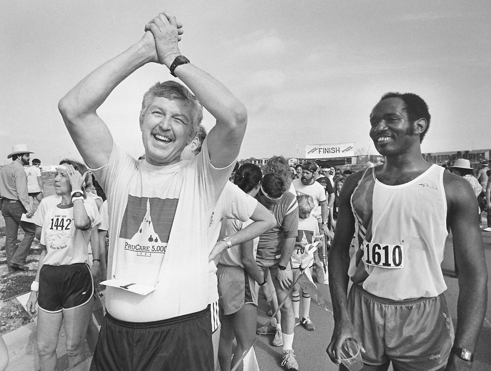 ©1984  Man happy after finishing 5,000 meter run.