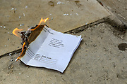 A student burns their A-level results during a demonstration in Parliament Square, Central London on Sunday, Aug 16, 2020. Students are reacting to downgrading of A-Level results as a result of the Covid-19 pandemic. (VXP Photo/ Vudi Xhymshiti)