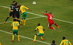 Mexico's Guillermo Franco (9) vs South Africa's  goalkeeper Itumeleng Khune and Lucas Thwala (15) during the Group A first round 2010 FIFA World Cup South Africa match between South Africa and Mexico at Soccer City Stadium on June 11, 2010 in Johannesburg, South Africa.  (Photo by Vid Ponikvar / Sportida)