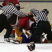 Referees try to break up a fight between Chris Eaden of Canterbury Red Devils and Brett Speirs of Southern Stampede during the Southern Stampede V Canterbury Red Devils National Ice Hockey League matches at the Queenstown Ice Arena, Southern Stampede won both series games 5-3 and 5-2. Queenstown, South Island, New Zealand, 16th July 2011