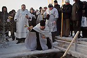 Moscow, Russia, 19/01/2006.Russian priests and Orthodox believers celebrate Epiphany at Serebryany Bor in northern Moscow. Priests blessed the waters and followers baptised themselves by total immersion in the freezing Moscow River in temperatures of minus 30C.