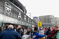 Fans buy a match day programme outside the Emirates Stadium, home of Arsenal<br /> <br /> Photographer Craig Mercer/CameraSport<br /> <br /> Football - Barclays Premiership - Arsenal v West Ham United - Saturday 14th March 2015 - Emirates Stadium - London<br /> <br /> © CameraSport - 43 Linden Ave. Countesthorpe. Leicester. England. LE8 5PG - Tel: +44 (0) 116 277 4147 - admin@camerasport.com - www.camerasport.com