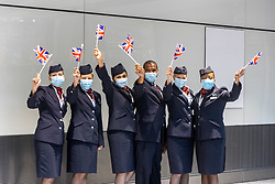 Licensed to London News Pictures. 09/08/202. London, UK. BA staff wave flags as Jason and Laura Kenny arrive at London Heathrow Terminal 5 from Tokyo this afternoon as Team GB celebrate 22 gold medals in one of the most successful Olympics on record. Jason and Laura Kenny became Britain's most successful Olympic athletes with Jason clinching his 7th gold and Laura winning her 5th gold including a gold and silver at the Tokyo games. Photo credit: Alex Lentati/LNP