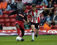 Photo: Jonathan Butler.<br />Southampton v Stoke City. Coca Cola Championship. 21/10/2006.<br />Grzegorz Rasiak of Southampton fights for the ball with Salif Diao of Stoke.