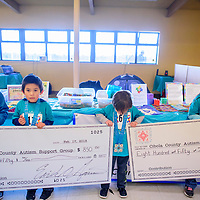 during the 2018 Mount Taylor Quadrathlon in Grants Saturday.   <br /> <br /> Cibola County Autism Support Group<br /> <br /> Landen Smith<br /> 5 years old <br /> <br /> Cathy Rougemont<br /> Anthony<br /> 5