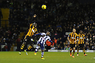 Hull city's Yannick Sagbo (l) challenges WBA's Youssouf Mulumbu. Barclays Premier league, West Bromwich Albion v Hull city at the Hawthorns in West Bromwich, England on Saturday 21st Dec 2013. pic by Andrew Orchard, Andrew Orchard sports photography.