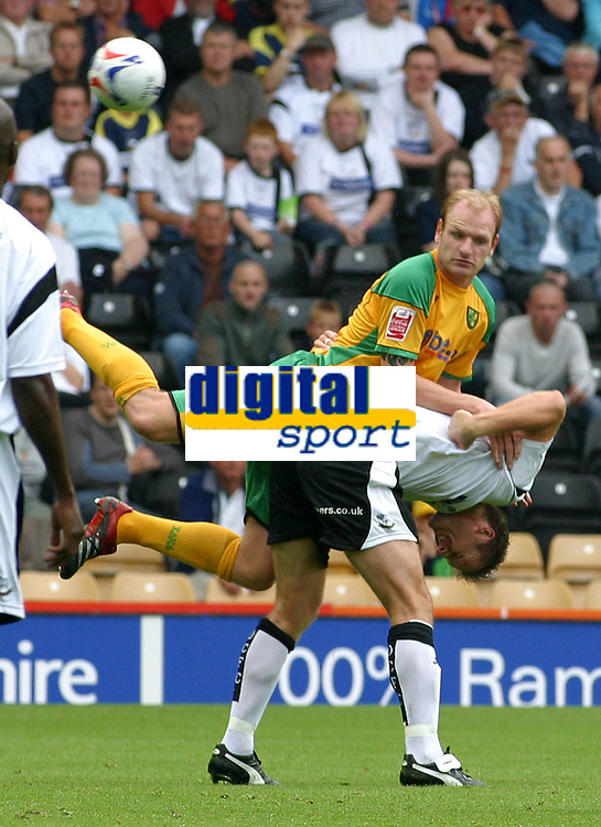 Photo: Dave Linney.<br />Derby County v Norwich City. Coca Cola Championship. 19/08/2006.Norwich's Lee Croft(L) hitches a ride from  Steve Howard