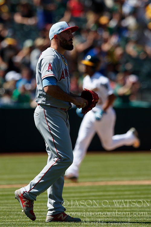 OAKLAND, CA - JUNE 17: Marcus Semien #10 of the Oakland Athletics rounds the bases after hitting a home run off of Blake Parker #53 of the Los Angeles Angels of Anaheim during the ninth inning at the Oakland Coliseum on June 17, 2018 in Oakland, California. The Oakland Athletics defeated the Los Angeles Angels of Anaheim 6-5 in 11 innings. (Photo by Jason O. Watson/Getty Images) *** Local Caption *** Marcus Semien; Blake Parker