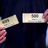 A patient displays his number 499 and 500 ticket after entering the Remote Area Medical clinic in Wise, Virginia July 20, 2012.  Organizers hope to bring free medical, dental and vision care to more than 3500 uninsured and underinsured people in the rural Virginia area.