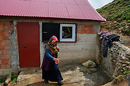 Esma, Yilmaz Civelek's wife in front of their home in the small village of Alaca Yaylası, in Turkey's northern Pontic mountains, and a common place for whistling as a method of communication.