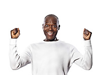 Portrait of an expressive Afro American man celebrating success in studio on white isolated background