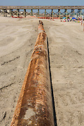 The Army Corps of Engineers uses a large pipeline to restore the beach during a major beach replenishment project May 12, 2014 in Folly Beach, SC.