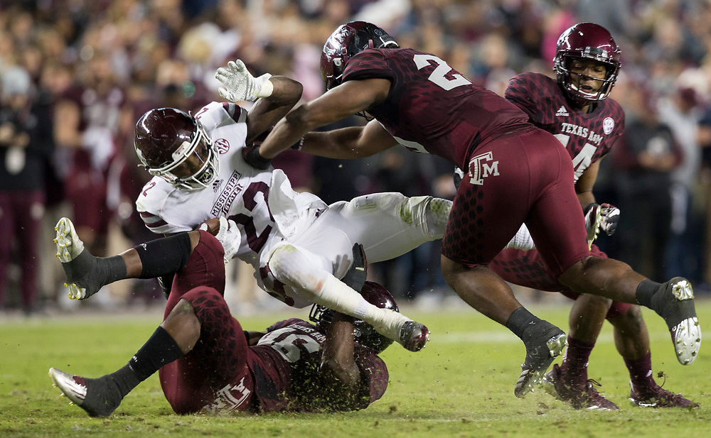 Mississippi State running back Aeris Williams (22) is knocked off his feet by Texas A&M linebacker Tyrel Dodson (25) during the second quarter off an NCAA college football game on Saturday, Oct. 28, 2017, in College Station, Texas. (AP Photo/Sam Craft)