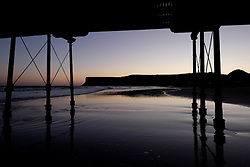(c) Licensed to London News Pictures. 04/12/2015<br /> Saltburn. UK. <br /> The outline of the cliffs of Huntcliff can be seen through the legs of the pier on Saltburn beach.<br /> Photo credit : Ian Forsyth/LNP