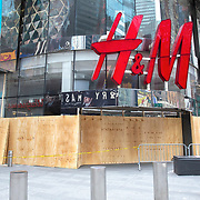 Businesses in Times Square board up windows in preparation for another expected night of protests due to the killing of George Floyd by a Minnesota Police Officer on Tuesday, June 2, 2020 in Manhattan, New York.  A citywide 8 p.m. curfew was ordered by NY Mayor Bill de Blasio amid the Floyd protests. (Alex Menendez via AP)