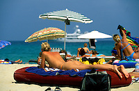 Young sunbathers on Tahiti Beach at St. Tropez,  Côte d'Azur, the French Riviera - Photograph by Owen Franken