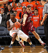 Nov 6, 2010; Charlottesville, VA, USA; Roanoke College g Matt Crizer (25) reaches for the ball from Virginia Cavaliers g KT Harrell (24) Saturday afternoon in exhibition action at John Paul Jones Arena. The Virginia men's basketball team recorded an 82-50 victory over Roanoke College.