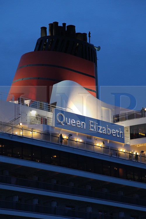 © Licensed to London News Pictures. 09/05/2014. Southampton, UK. The red funnel of the Queen Elizabeth cruise liner. Firework celebrations marking the 10-year anniversary of the Cunard flagship, Queen Mary 2, take place in the port of Southampton this evening, 9th May 2014. All 'three queens' of the Cunard fleet were present at the event, which included a 10-minute firework display, one minute for every year that the QM2 has been in service. Photo credit : Rob Arnold/LNP