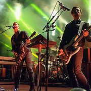 "COLUMBIA, MD - July 17th, 2014 - Dean Fertita, Josh Homme and Michael Shuman of Queens of the Stone Age perform at Merriweather Post Pavilion. The band's 2013 album, ""…Like Clockwork,"" was the group's first album to top the US Billboard 200 album charts. (Photo by Kyle Gustafson / For The Washington Post)"