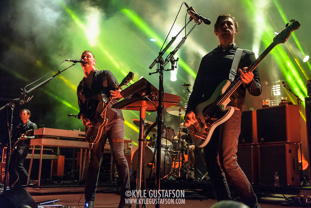 """COLUMBIA, MD - July 17th, 2014 - Dean Fertita, Josh Homme and Michael Shuman of Queens of the Stone Age perform at Merriweather Post Pavilion. The band's 2013 album, """"…Like Clockwork,"""" was the group's first album to top the US Billboard 200 album charts. (Photo by Kyle Gustafson / For The Washington Post)"""