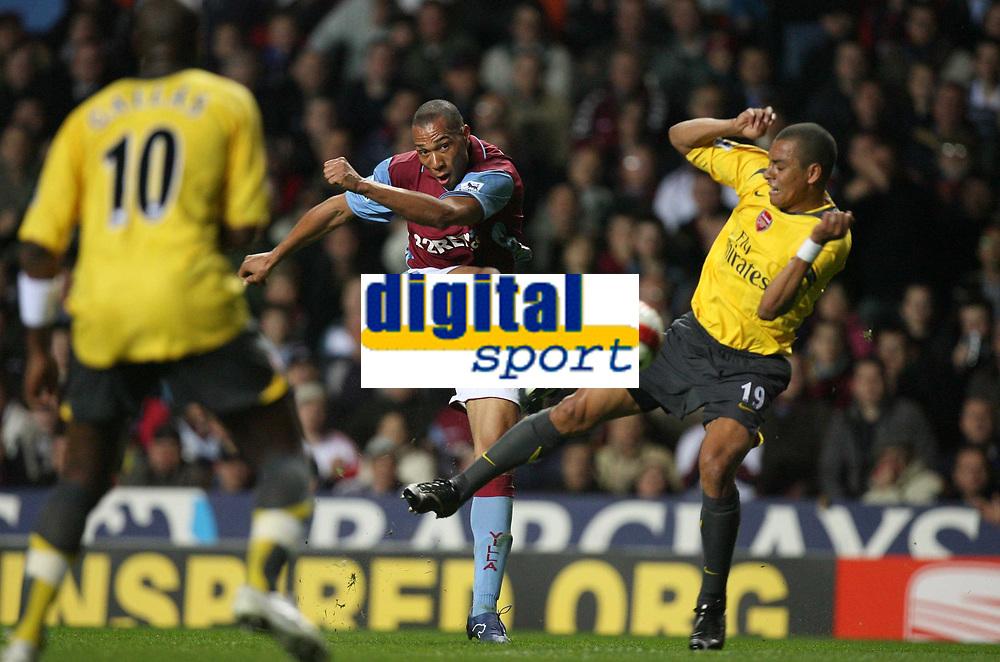 Photo: Rich Eaton.<br /> <br /> Aston Villa v Arsenal. The Barclays Premiership. 14/03/2007. John Carew centre of Aston Villa shoots, tackled by Gilberto