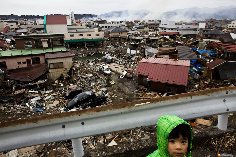 A local looks at devastation of Kesennuma city in Miyagi, Japan, March 15, 2011.