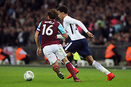 Dele Alli of Tottenham Hotspur (R) takes on Mark Noble of West Ham United (L). EFL Carabao Cup, 4th round match, Tottenham Hotspur v West Ham United at Wembley Stadium in London on Wednesday 25th October 2017.<br /> pic by Steffan Bowen, Andrew Orchard sports photography.
