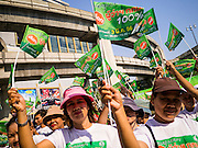 28 FEBRUARY 2013 - BANGKOK, THAILAND: Thai voters wave flags and placards encouraging 100% voter turnout at a turn out the vote rally in Bangkok Thursday. Several hundred people participated in the get out the vote rally in central Bangkok near the MBK shopping center Thursday. Friday March 1 is the final day of campaigning in the Bangkok governor's race. Bangkok residents go to the polls Sunday, March 3 to elect a new Governor.      PHOTO BY JACK KURTZ