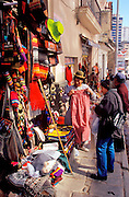 """BOLIVIA, LA PAZ Mercado de Hechiceria or """"witches market"""" on Ave. Sagamaga in the old colonial area with street vendors and craft shops"""
