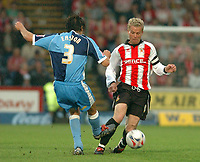 Photo: Leigh Quinnell.<br /> Wycombe Wanderers v Cheltenham Town. Coca Cola League 2, Play off Semi Final. 13/05/2006. Cheltenhams John Finnigan side steps Wycombes Clint Easton.