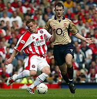 Photo Aidan Ellis.<br />Arsenal v Sheffield United (FA Cup Semi Final) <br />Old Trafford. 13/04/2003.<br />Sheffield's Rob Kozluk and Arsenal's Francis jeffers