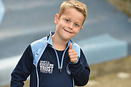 A thumbs up from a young Wycombe fan during the EFL Sky Bet League 1 match between Wycombe Wanderers and Oxford United at Adams Park, High Wycombe, England on 15 September 2018.