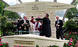 Jockey Andrea Atzeni and trainer Willie Mullins are presented with the trophies by Craig Revel Horwood after winning the Ascot Stakes with Lagostovegas during day one of Royal Ascot at Ascot Racecourse.