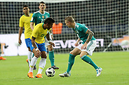 Paulinho (Brazil) and Tony Kroos (Germany) during the International Friendly Game football match between Germany and Brazil on march 27, 2018 at Olympic stadium in Berlin, Germany - Photo Laurent Lairys / ProSportsImages / DPPI