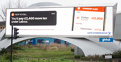 Conservative party General Election Campaign 2019 launch of electronic posters  across the country – highlighting that taxpayers would, on average, have to pay £2,400 more tax every year under Labour.<br /> this poster was pictured at Vauxhall Cross Nine Elms, London, Great Britain <br /> 12th November 2019 <br /> <br /> Photograph by Elliott Franks