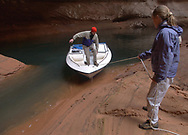 New landing dock in the Cathedral area in Glen Canyon. Nicole Schmutz steadies her companion's boat as he makes his way on to solid ground.