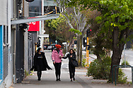 Woman are seen walking towards South Melbourne Market during COVID-19 in Melbourne, Australia. Melbourne held hostage to a Premier unwilling to open up. After promising businesses and Melbournians that 'significant' announcements over easing restrictions would be made today, Premier Daniel Andrews once again backtracked on his commitments and has delayed Melbourne's reopening. This comes as the Northern Metro cluster continues to grow. (Photo by Dave Hewison/Speed Media)