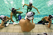 Underwater hockey (also called Octopush) is a non-contact sport in which two teams compete to maneuver a puck across the bottom of a swimming pool into goals. This pictures are about the only amateur portuguese underwater hockey team who is training to the european championship in Turkey