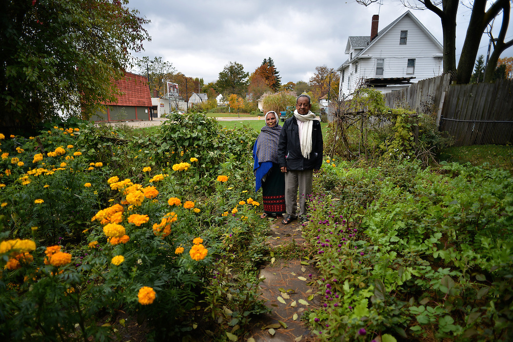 Couple standing in the garden outside of their home in North Hill.