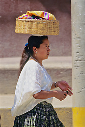 Woman Carrying Basket On Head
