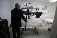 Preparing a body for international transport, Ft.Greene, Brooklyn